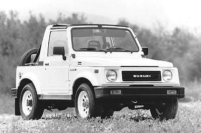 1991 Suzuki Samurai - Note the convertible and 'round hole' wheels